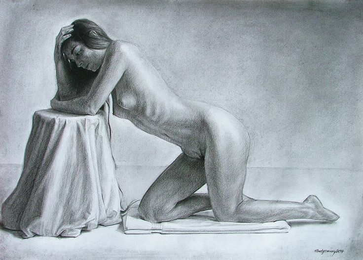 A figure drawing of a kneeling model in charcoal on A2 paper.